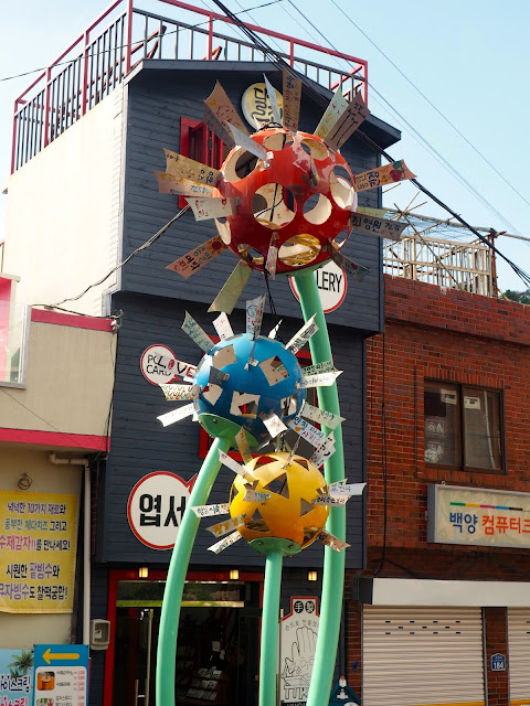 """Sweet Whispers of Dandelions"" metal flower art installation in Gamcheon Village, Busan, South Korea"