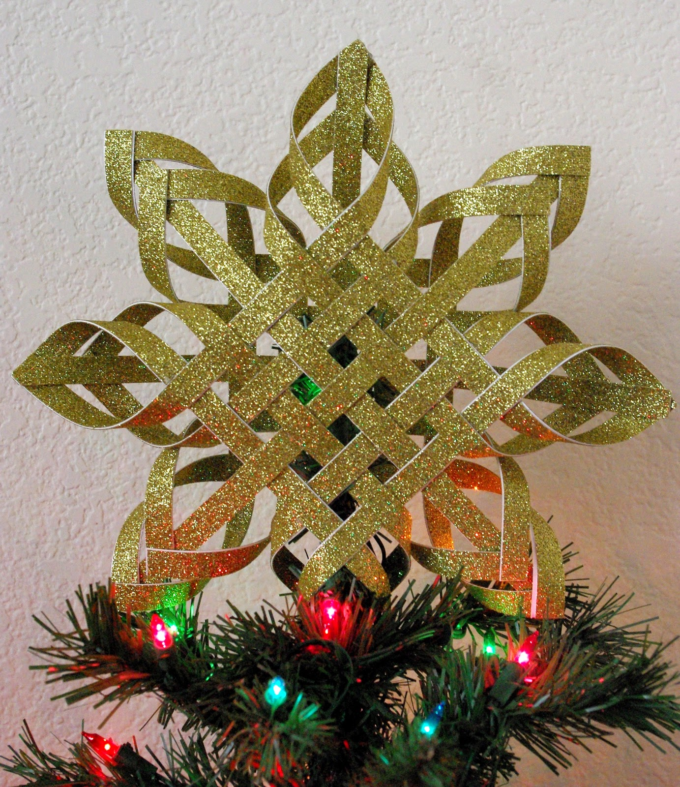 all youll need to make this gorgeous star is a sheet of 12 x 12 glittered cardstock scissors and glue hot glue works best - How To Make A Christmas Tree Topper
