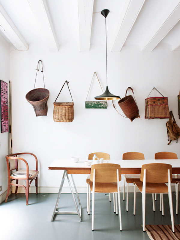 Add interest to wall with woven baskets.