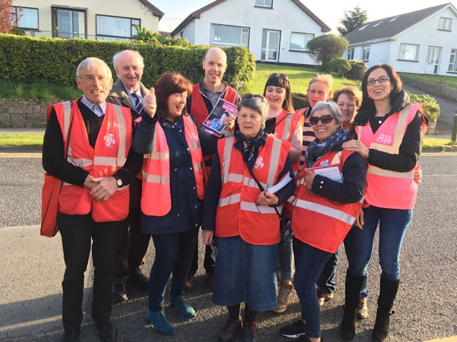 A photo of canvassers knocking on doors in the town of Sligo