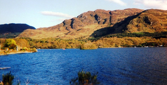 A remote highland loch with hills in the background