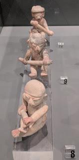Tolita canoe paddlers miniatures