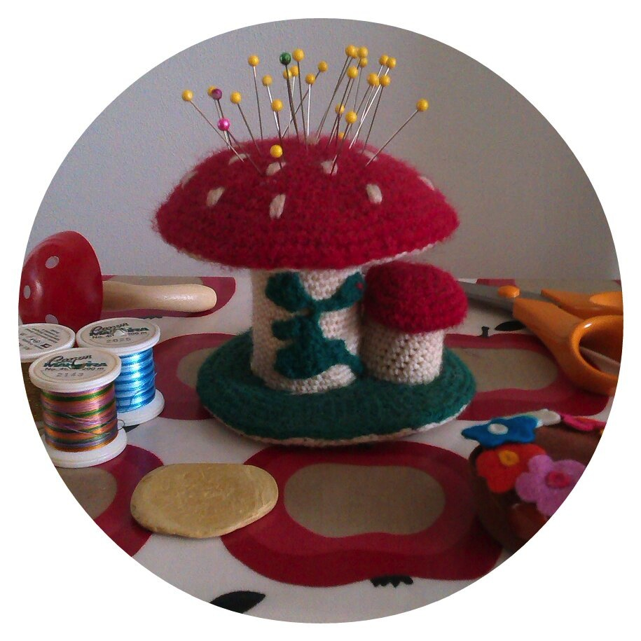 Sewing notions with Omi's mushroom pincushion
