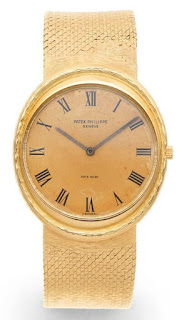 Patek Philippe 18K gold automatic watches