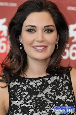 Cyrine Abdel Nour, a singer and actress and fashion model, Lebanese, born February 211,977 in Lebanon.