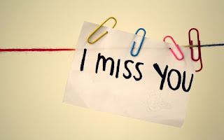 i miss you on paper note attached with pins