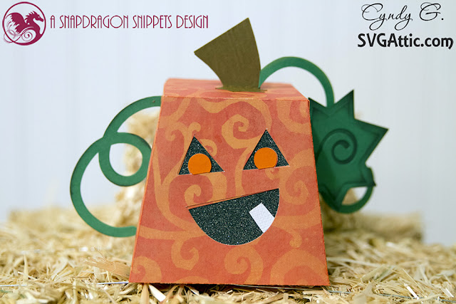 pumpkin treat box sitting on a bale of hay