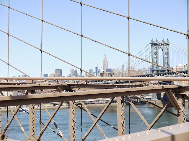 View of Empire State building on Brooklyn Bridge