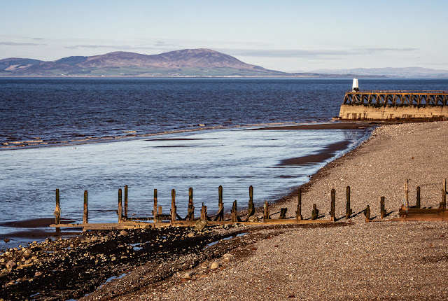 Photo of Maryport shore with the Scottish hills on the far side of the Solway Firth