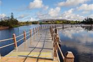 Wooden boardwalk floating on Acres Lake Leitrim