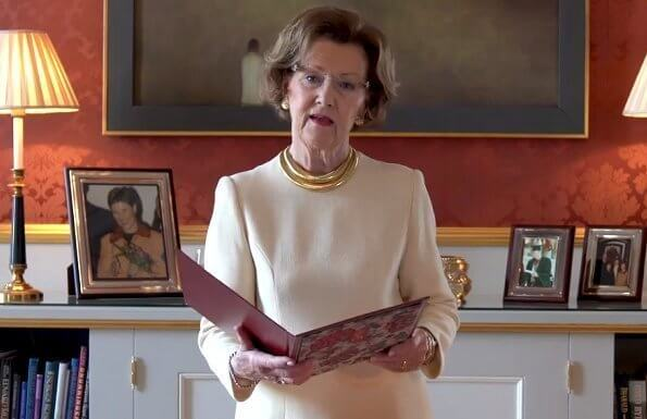 On the occasion of the International Nurses Day 2020, Queen Sonja' gold necklace by Dior. Valentino white dress