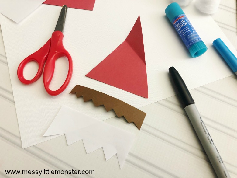 Elf on the shelf cupcake liner craft. Easy elf craft for kids.