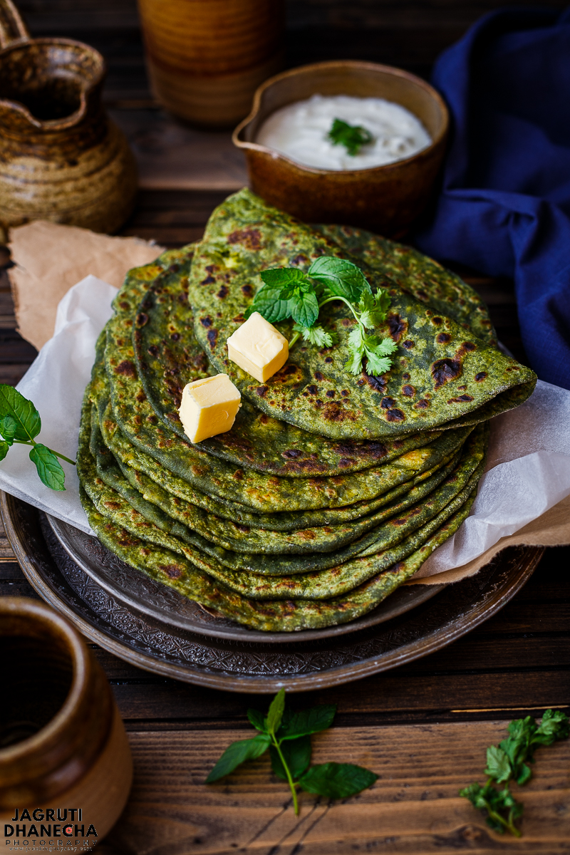 Palak, Paneer and Matar Paratha (shallow-fried Indian-style spinach, Indian cottage cheese and green peas flat bread)  are perfect breakfast or brunch consisting of a spinach dough and stuffed with mildly spiced paneer and green peas stuffing. Each and every morsel is bursting with delicious flavours that you won't forget in a hurry!