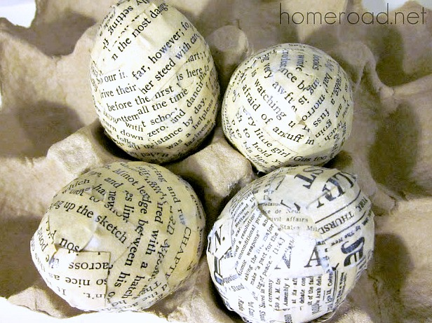Easter eggs covered in book page scraps
