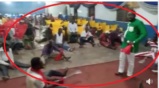 Watch brainwashed church goers  beat satan with pangas as they usher in the new year under the instructions of their pastor (Video).