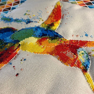cross stitched hummingbird quilted wall hanging