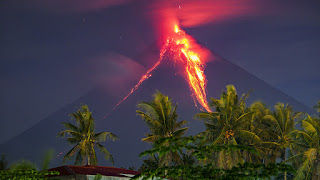 Deadly mudflows threaten residents near erupting Philippine volcano