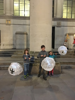 children holding paper lanterns