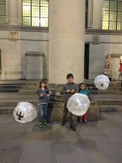 children holding paper lanterns