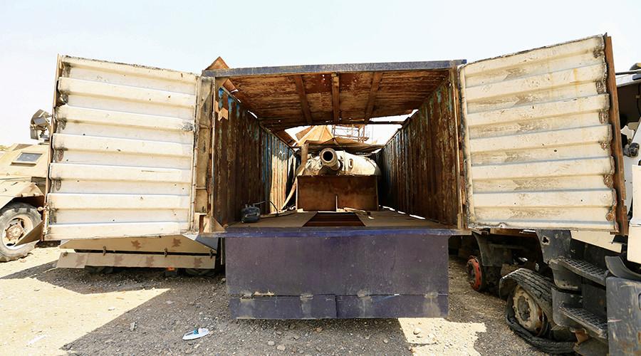 © Thaier Al-Sudani — Source: Reuters—  Canon dans une remorque