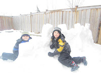 Kids playing in the snow, snow fort, igloo, building with snow, winter activities, outdoor activities