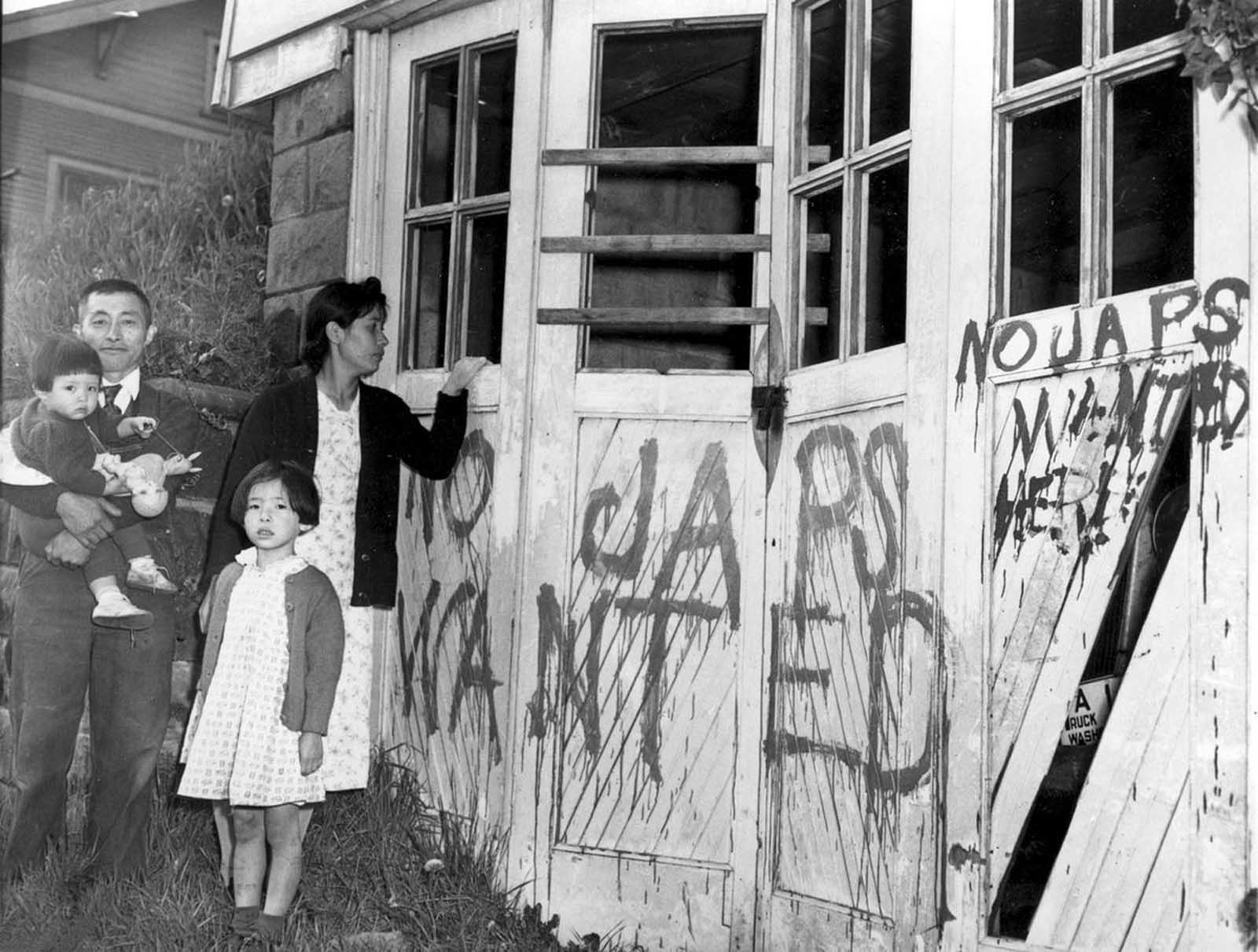 A Japanese family returning home from a relocation center camp in Hunt, Idaho, found their home and garage vandalized with anti-Japanese graffiti and broken windows in Seattle, Washington, on May 10, 1945.
