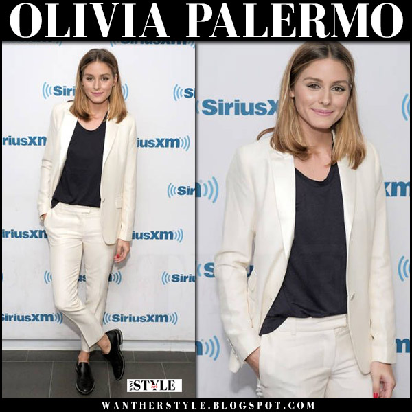 Olivia Palermo in white jacket and white trousers with black top la perla what she wore july 31 2017