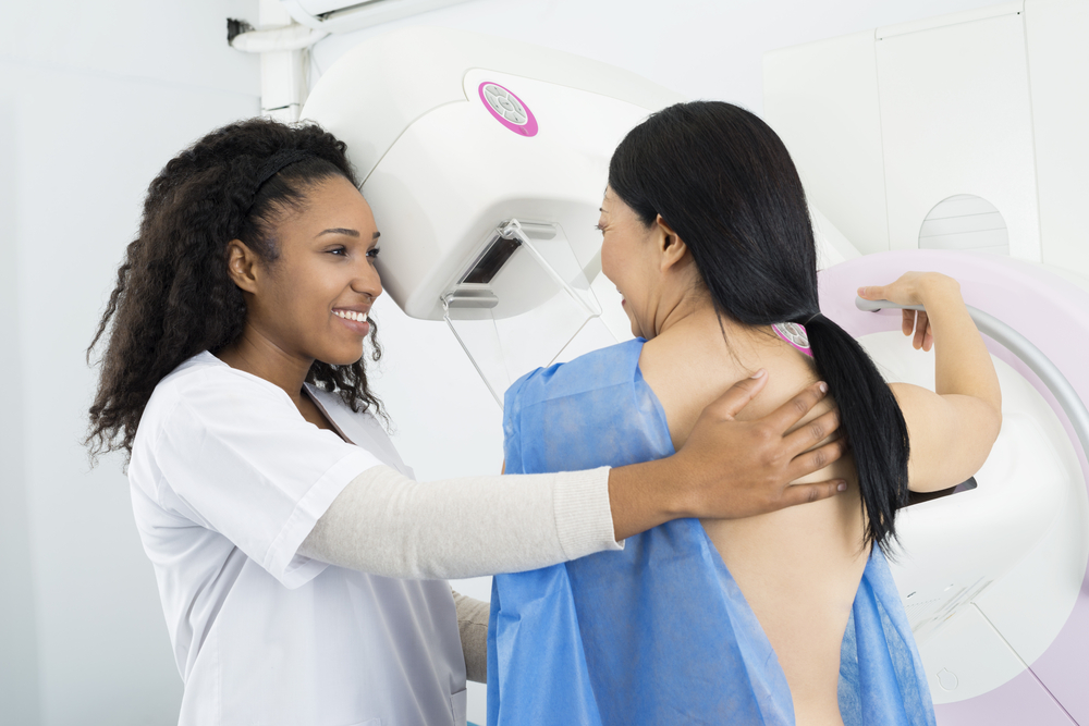 women receiving a mammogram