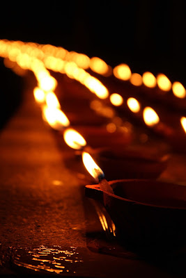 Light earthen lamps or diyas
