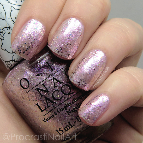 Swatch of the pink glitter nail polish OPI Charmmy & Sugar