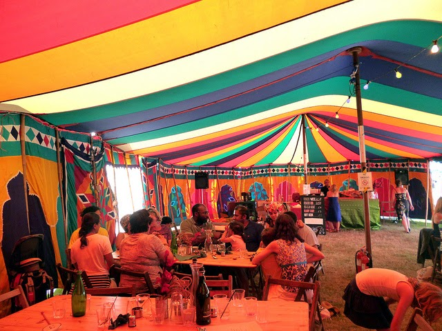 inside a bright coloured festival tent camp bestival