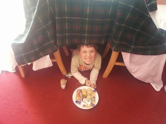 Boy in Homemade Den