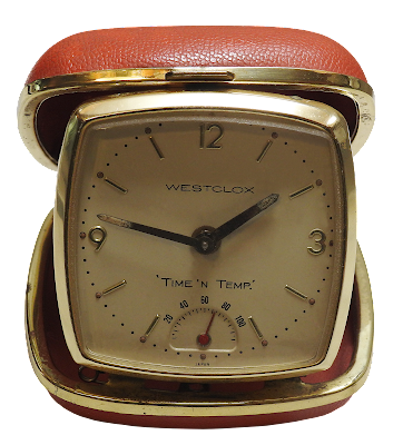 An old travel style alarm clock that also tells you the temperature.