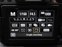Choose the shooting mode from the Q Menu
