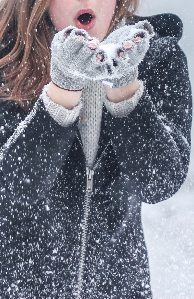 A woman holding snow.