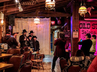 tourists with Wild Bill at Saloon #10 in Deadwood, South Dakota