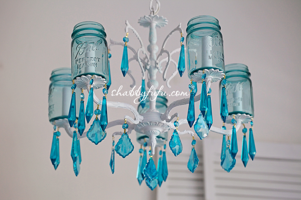 Adding pops of color to a room - aqua chandelier made with mason jars and blue crystals