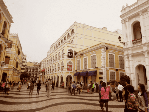 An avenue surrounded by antique buildings at Largo do Senado, Macau