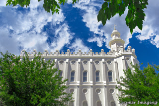 Cramer Imaging's professional quality fine art photograph of the St. George Utah temple in profile with plants and clouds in sky