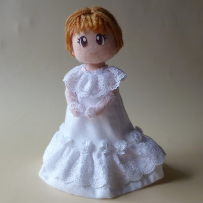 Doll in white dress