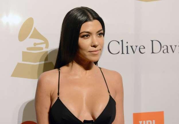 Kourtney Kardashian Has A Massive Photo Of Herself As Jesus On The Cross