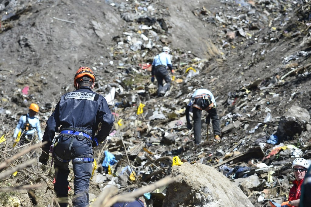 70 Of The Most Touching Photos Taken In 2015 - Rescue workers search the site of the Germanwings plane crash near the French Alps. The plane's co-pilot purposefully crashed the plane, killing all 150 on board.
