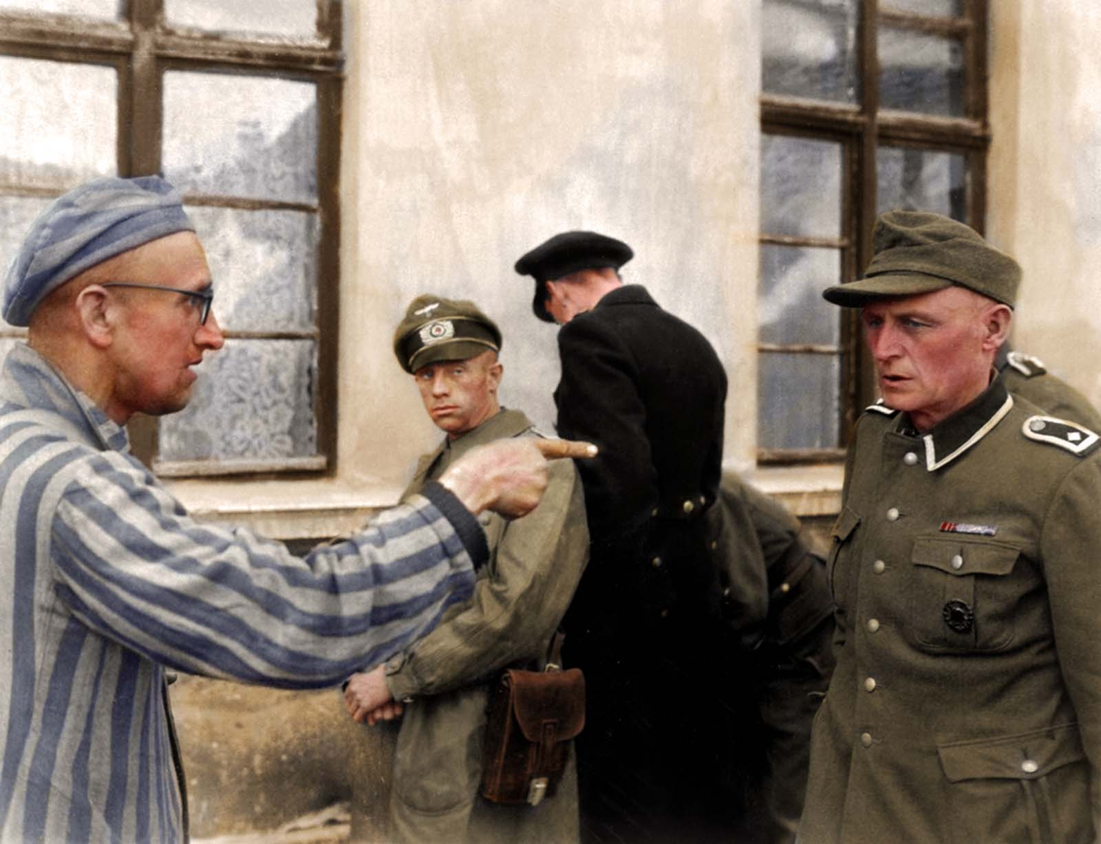 Russian survivor liberated U.S. Army in Buchenwald camp in Germany identified a former guard who were brutally beating prisoners. April 14, 1945. Colorized version. The original photograph.