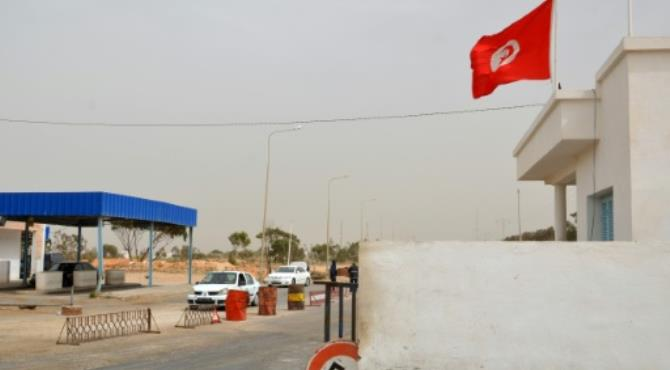 Vehicles wait near the Tunisian customs post at the border crossing with Libya in March 2016 after it was reopened after a two-week closure in response to a deadly jihadist attack on a town near the frontier.