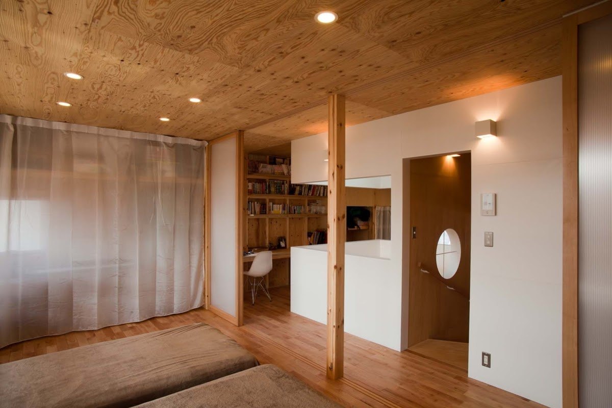 17-Second-Bedroom-Glass-Sliding-Doors-Mizuishi-Architects-Atelier-Light-and-Airy-House-in-Japanese-Architecture-www-designstack-co