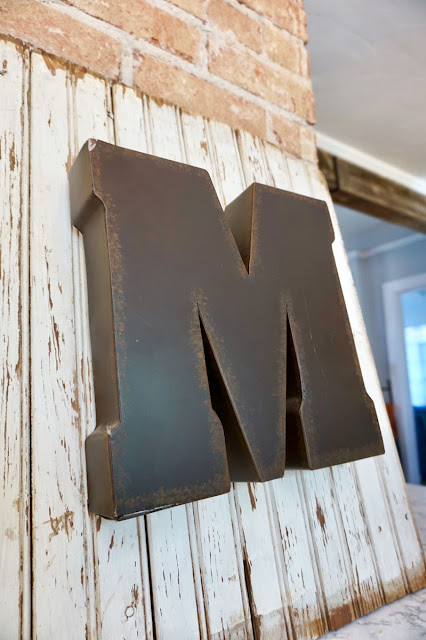 Old bead board with the letter M attached