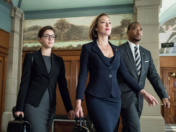 Image of two female and one male persons walking through a courtroom from the legal tv show drama Goliath, an Amazon Prime Original production