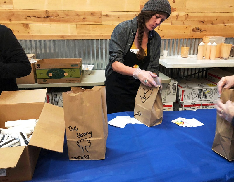 Katherine Clement prepares bagged lunches
