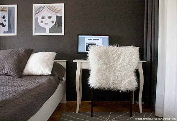 bedroom with dark grey walls with ikea furniture