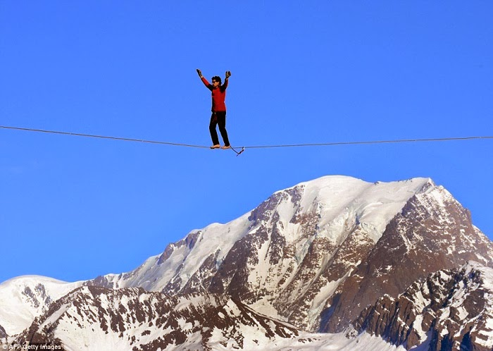 French Highliner Performs Death-Defying Walk On Cable Car Wire 1,200ft Above Mont Blanc In The French Alps